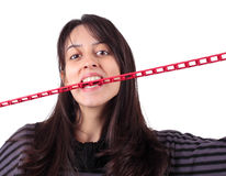 Girl biting a chain Stock Photography