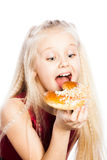 Girl biting a croissant Stock Photography