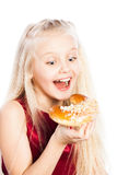 Girl biting a croissant Stock Images
