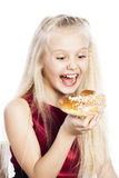 Girl biting a croissant Stock Photo