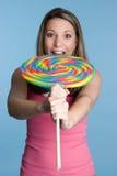 Girl Biting Giant Lollipop Royalty Free Stock Photography