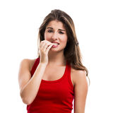 Girl biting her nails Royalty Free Stock Photos
