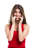 Girl Biting Her Nails Royalty Free Stock Images