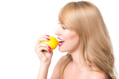Girl biting a lemon Royalty Free Stock Photos