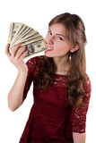 Girl biting money Royalty Free Stock Images