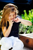 Girl biting nails. Bad habits - young girl biting her nails royalty free stock images