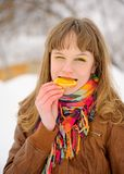 Girl biting orange slice Royalty Free Stock Photography