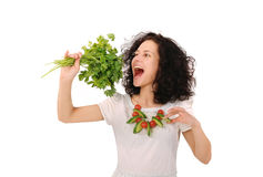 Girl biting parsley Stock Image