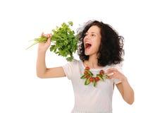 Girl biting parsley Stock Image
