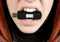 Girl biting an usb flash drive Royalty Free Stock Image