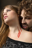 Girl bitten by a vampire. With bloody mouth Stock Images