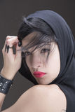 Girl in black. Girl is looking across the sholder Stock Images