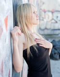 Girl in black on background of wall Stock Photo