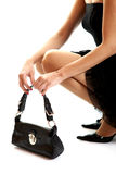 Girl and Black Bag Royalty Free Stock Images
