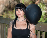 Girl with a black balloon Stock Photos