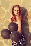 Girl with black balloons Stock Photos