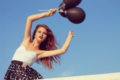 Girl with black balloons Royalty Free Stock Image