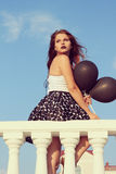 Girl with black balloons Royalty Free Stock Photos