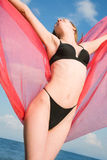 Girl in a black bathing suit Stock Photos
