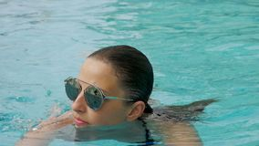 Girl in a black bathing suit and sunglasses stock video footage