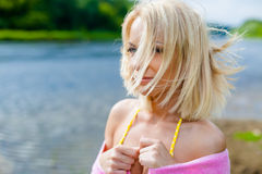 Girl in a black bikini on the beach Stock Photography
