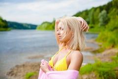 Girl in a black bikini on the beach Stock Image