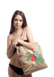 Girl in black bikini with funny beach bag Stock Images