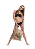 Girl in black bikini stand with funny beach bag Stock Image