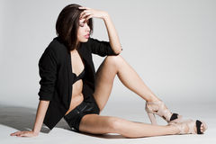 Girl in black blazer and leather shorts Royalty Free Stock Photo