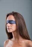 Girl with black blind fold Stock Photos
