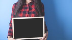 Girl with black board stock photo