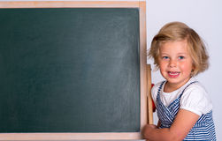 Girl with black board Stock Photos