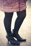 Girl with black boot and stocking wearing pink jacket - retro st Royalty Free Stock Photos