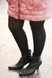 Girl with black boot and stocking wearing pink jacket Royalty Free Stock Photography