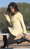 Girl in black boots. Portrait of African-American girl in black boots (focus on boots Stock Photos