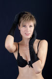 Girl in a black bra and gloves Royalty Free Stock Photography