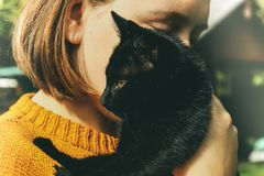 Girl and black cat royalty free stock photo