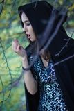 The girl with the black cloak in the forest Royalty Free Stock Photography