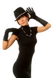 The girl in black clothes. On a white background with a hat hat Stock Photo