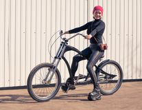 The girl in black clothes the cool bicycle with th Royalty Free Stock Images