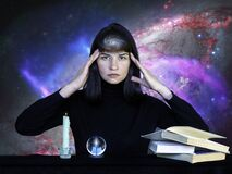 A girl in black clothes sitting at a table with books, a sphere and a burning candle against background of starry sky