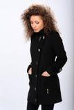 Girl in a black coat Stock Image