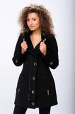 Girl in a black coat Royalty Free Stock Photos