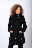 Girl in a black coat Stock Image