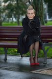 Girl in black coat Royalty Free Stock Image
