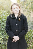 Girl with black coat Royalty Free Stock Image