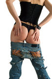 Girl in a black corset and blue jeans Royalty Free Stock Photography