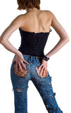 Girl in a black corset and blue jeans. The young girl in a black corset and blue jeans. Isolation on white Stock Images