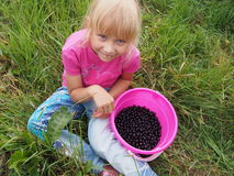 Girl with black currant Royalty Free Stock Images