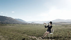Girl in black cylinder Stock Image